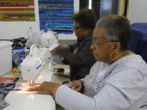 two ladies at their sewing machines